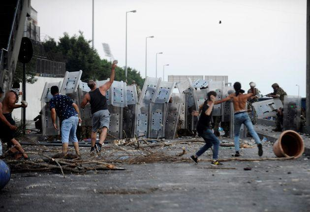 Protestors throw stones at Lebanese army members in Beirut in July this year as demonstrations continue (Photo: Xinhua News Agency via Xinhua News Agency via Getty Ima)