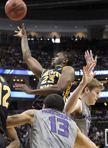 Southern Mississippi's Angelo Johnson (23) shoots over Kansas State's Angel Rodriguez (13) in the first half of an East Regional NCAA tournament second-round college basketball game on Thursday, March 15, 2012, in Pittsburgh. (AP Photo/Keith Srakocic)