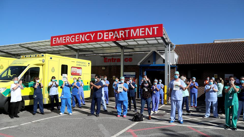 NHS staff outside the William Harvey Hospital in Ashford, Kent, join in the pause for applause to salute the NHS 72nd birthday.