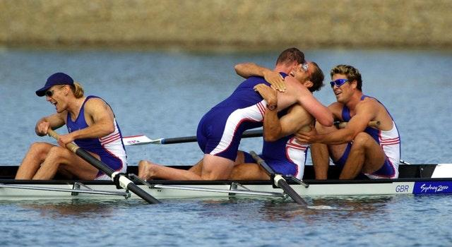 Tim Foster, Matthew Pinsent, Steve Redgrave, and James Cracknell celebrate after winning gold in Sydney