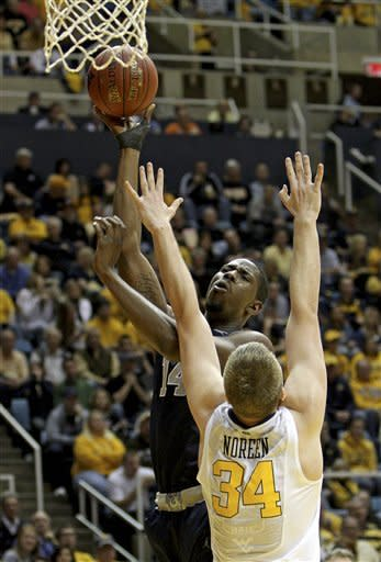 Georgetown's Henry Sims (14) shoots over West Virginia's Kevin Noreen (34) during the first half of an NCAA college basketball game at WVU Coliseum in Morgantown, W.Va., on Saturday, Jan. 7, 2012. (AP Photo/David Smith)