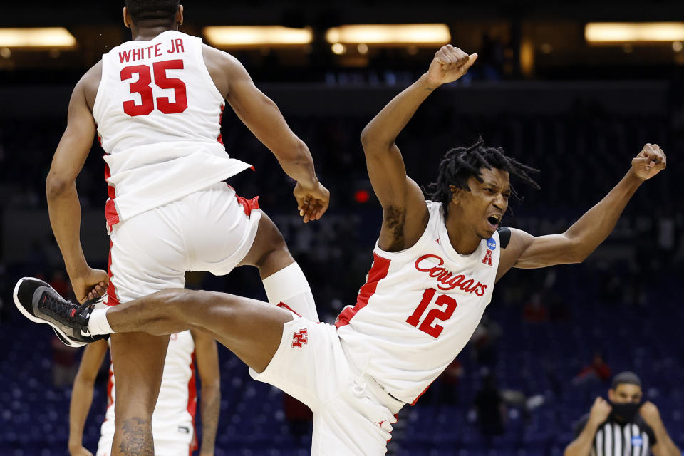 INDIANAPOLIS, INDIANA - MARCH 21: Fabian White Jr. #35 and Tramon Mark #12 of the Houston Cougars celebrate at the NCAA tournament
