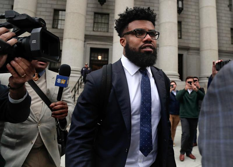 Dallas Cowboys NFL football star Ezekiel Elliott walks out of federal court on Nov. 9, 2017, in New York. Elliott's lawyers argued before a Manhattan federal appeals court on whether the Cowboys running back should be allowed to play while three judges decide the fate of his six-game suspension for alleged domestic violence.