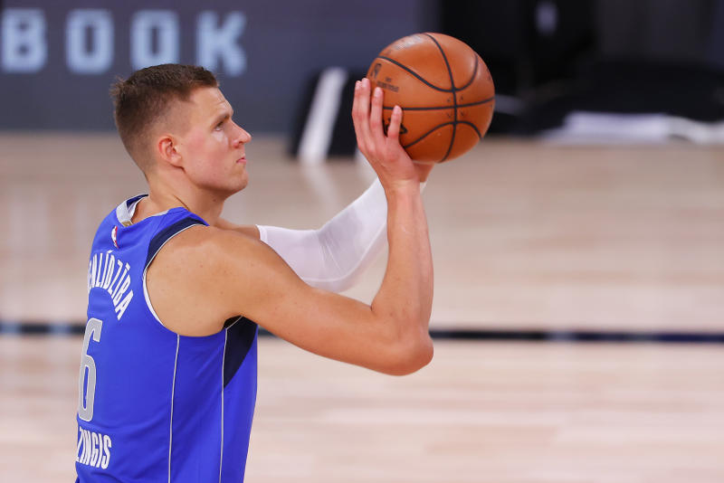 LAKE BUENA VISTA, FLORIDA - AUGUST 21: Kristaps Porzingis #6 of the Dallas Mavericks shoots a free throw against the LA Clippers during the fourth quarter in Game Three of the Western Conference First Round during the 2020 NBA Playoffs at AdventHealth Arena at ESPN Wide World Of Sports Complex on August 21, 2020 in Lake Buena Vista, Florida. NOTE TO USER: User expressly acknowledges and agrees that, by downloading and or using this photograph, User is consenting to the terms and conditions of the Getty Images License Agreement. (Photo by Mike Ehrmann/Getty Images)