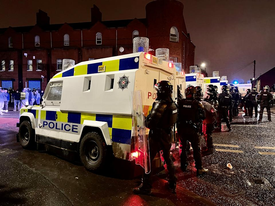 PSNI officers and Land Rovers on the nationalist side of the Springfield Road in Belfast after dispersing people from the area, following further unrest. Picture date: Wednesday April 7, 2021.
