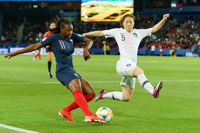 Kadidiatou Diani of France and Do-Yeon Kim of Korea battle for the ball during the 2019 FIFA Women's World Cup France group A match between France and Korea Republic at Parc des Princes on June 7, 2019 in Paris, France. (Photo by TF-Images/Getty Images)