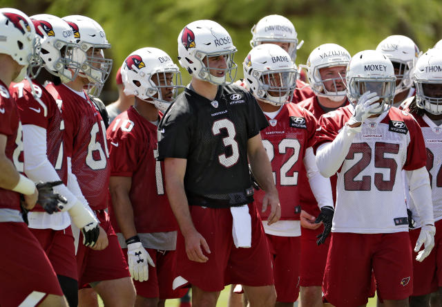 Arizona Cardinals' first-round draft pick Josh Rosen (3) stands with his teammates during NFL football rookie camp Friday, May 11, 2018, in Tempe, Ariz. (AP Photo/Matt York