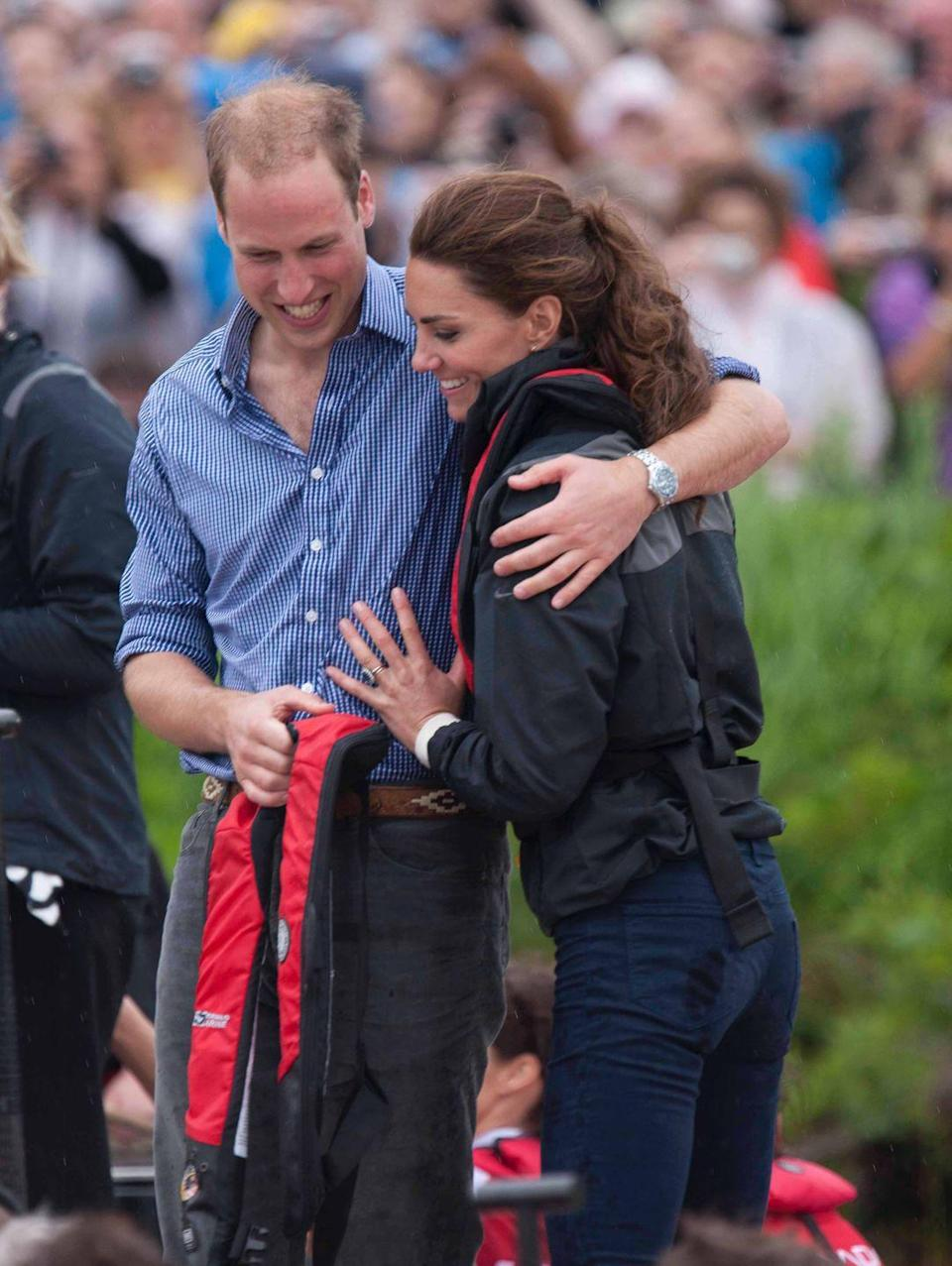 <p>The pair hugged it out after taking part in a dragon boat race at Dalvay-by-the-sea during the couple's North American Tour, July 2011.</p>