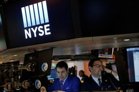 Traders work on the trading floor at the opening of the markets at the New York Stock Exchange (NYSE) in Manhattan, New York City, U.S., February 27, 2017. REUTERS/Andrew Kelly