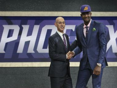 The Phoenix Suns didn't have to go far to get Deandre Ayton in the NBA draft, as they made the towering Bahamian teenager their first No 1 overall pick in franchise history on Thursday.