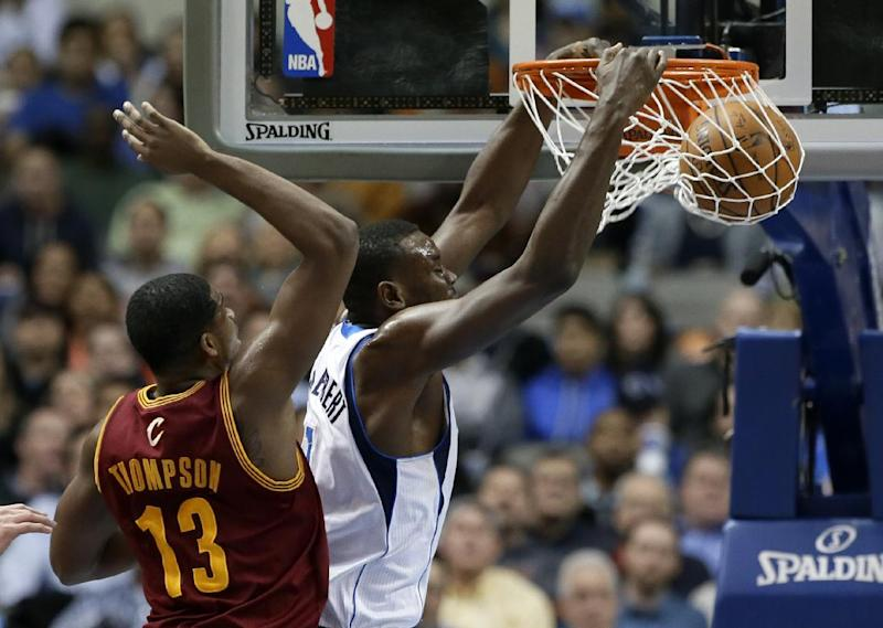 Dallas Mavericks' Samuel Dalembert (1) of Haiti dunks after getting past the defense of Cleveland Cavaliers' Tristan Thompson (13) in the first half of an NBA basketball game, Monday, Feb. 3, 2014, in Dallas. (AP Photo/Tony Gutierrez)