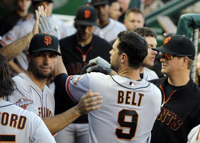 San Francisco Giants' Brandon Belt (9) celebrates after his solo home run during the sixth inning of a baseball game against the San Francisco Giants at Nationals Park, Thursday, Aug. 15, 2013, in Washington. (AP Photo/Alex Brandon)
