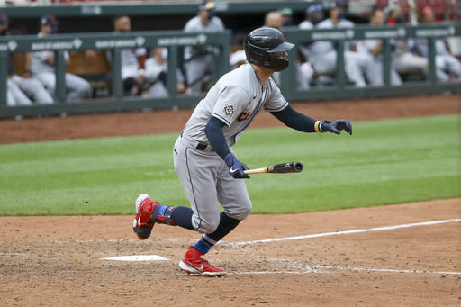 Cleveland Indians' Tyler Naquin hits an RBI-double during the 12th inning of a baseball game against the St. Louis Cardinals in St. Louis, Saturday, Aug. 29, 2020. (AP Photo/Scott Kane)