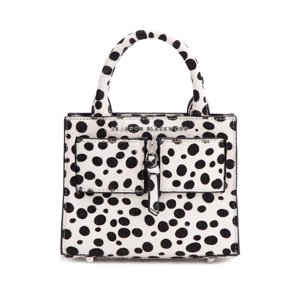 <p>While Cruella de Vil might be most commonly known as a Disney villain, the <span>Brandon Blackwood Kuei Bag in Dalmatian Ponyhair</span> ($170) is for the bride keeping up with all the latest Disney films.</p>