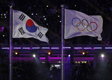 The South Korean flag and the Olympic flag. REUTERS/Damir Sagolj