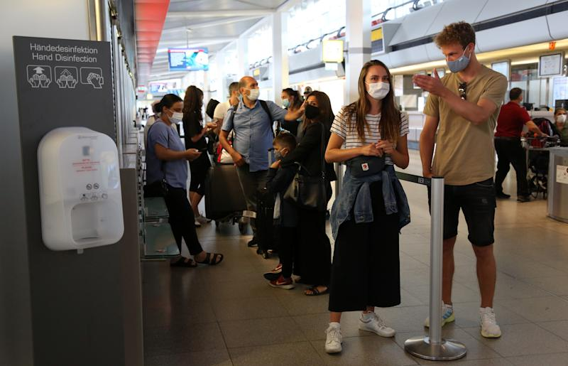 BERLIN, GERMANY - JULY 29: Newly-arrived passengers from a flight from California wait to be tested for coronavirus (COVID-19) at Tegel (TXL) airport on July 29, 2020 in Berlin, Germany. German airports are offering coronavirus tests to travelers in an effort to prevent a surge of COVID-19 cases amidst summer travel. (Photo by Adam Berry/Getty Images)
