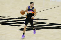 Phoenix Suns guard Devin Booker (1) dribbles against the Los Angeles Clippers during the first half of Game 2 of the NBA basketball Western Conference Finals, Tuesday, June 22, 2021, in Phoenix. (AP Photo/Matt York)