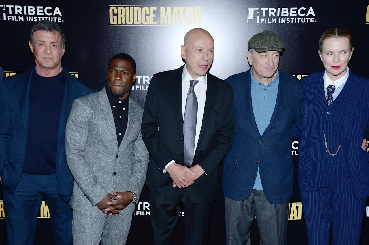 "NEW YORK, NY - DECEMBER 16: (L-R) Sylvester Stallone, Kevin Hart, Alan Arkin, Robert De Niro, and Kim Basinger attend the ""Grudge Match"" screening benefiting the Tribeca Film Insititute at Ziegfeld Theater on December 16, 2013 in New York City. (Photo by Dimitrios Kambouris/Getty Images)"