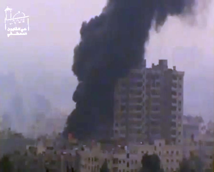 This image taken from video obtained from Ugarit News, which has been authenticated based on its contents and other AP reporting, shows smoke and fire billowing from an explosion in Damascus, Syria, Wednesday, Feb. 6, 2013. Heavy fighting erupted in Damascus Wednesday as government forces tried to hold back a new rebel effort to push the civil war into the heart of the Syrian capital, activists said.(AP Photo/Ugarit News via AP video)