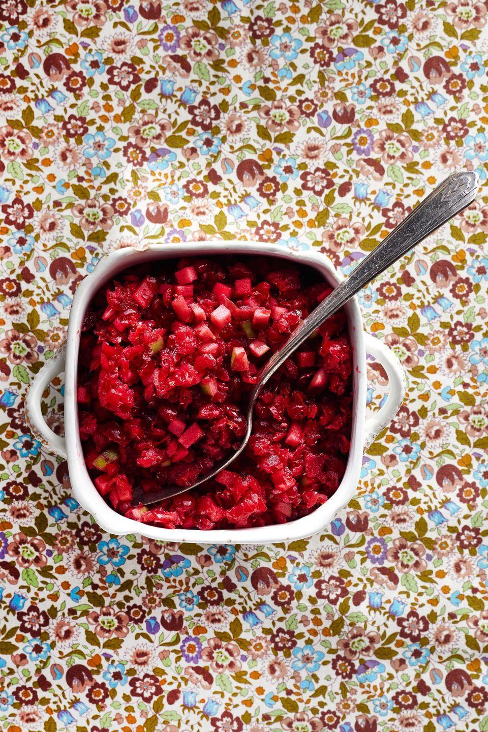 "<p>This cranberry relish gets a zesty kick from scallions and Granny Smith apples.</p><p><strong><a href=""https://www.countryliving.com/food-drinks/recipes/a36665/fresh-cranberry-apple-relish/"" rel=""nofollow noopener"" target=""_blank"" data-ylk=""slk:Get the recipe"" class=""link rapid-noclick-resp"">Get the recipe</a>.</strong></p>"