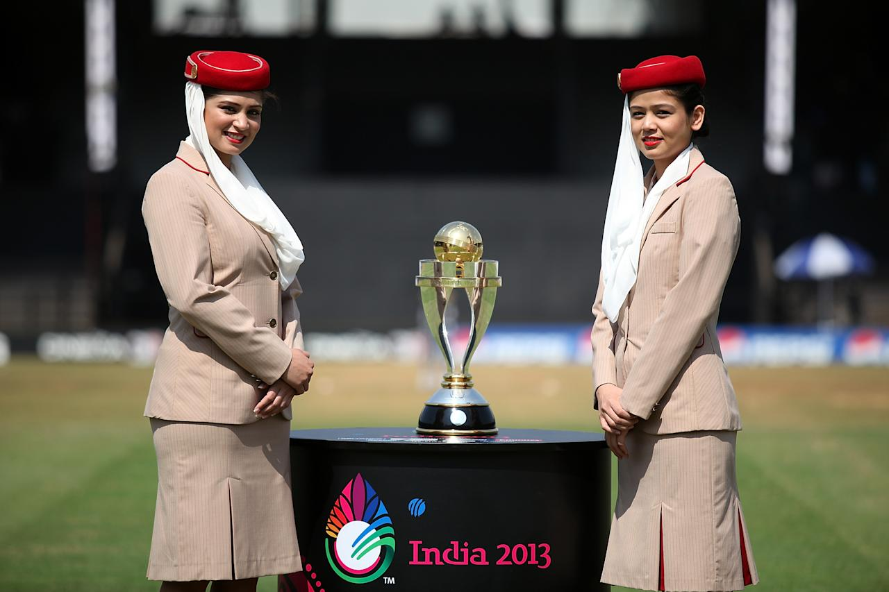 MUMBAI, INDIA - FEBRUARY 17: Emirates girls with the trophy ahead of the final between Australia and West Indies of the Women's World Cup India 2013 played at the Cricket Club of India ground on February 17, 2013 in Mumbai, India. (Photo by Graham Crouch/ICC via Getty Images)