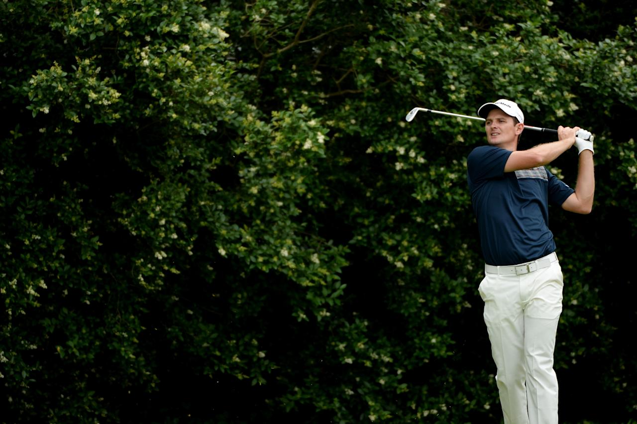 ARDMORE, PA - JUNE 16: Justin Rose of England watches his tee shot on the seventh hole during the final round of the 113th U.S. Open at Merion Golf Club on June 16, 2013 in Ardmore, Pennsylvania. (Photo by Ross Kinnaird/Getty Images)