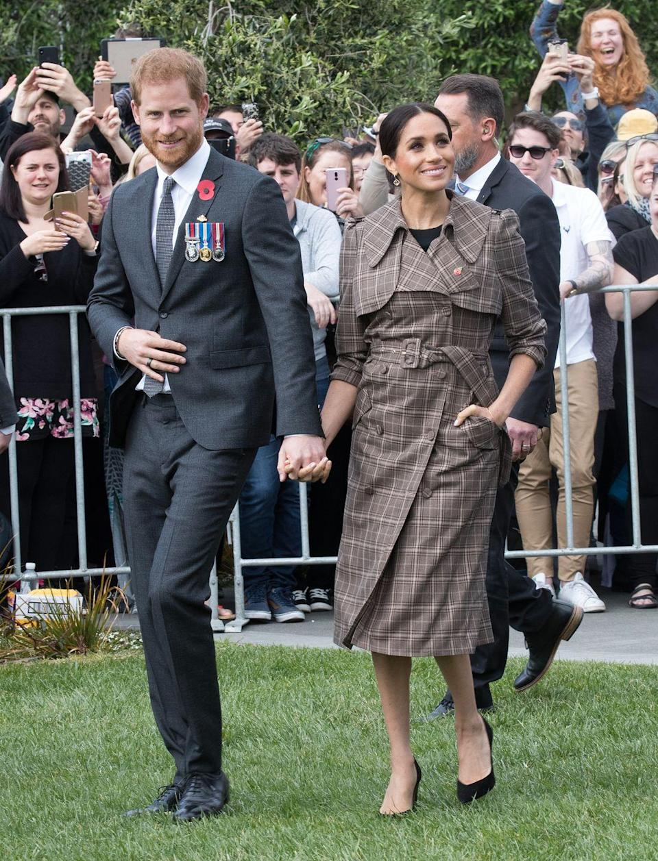 """<p>Harry and Meghan touched down in New Zealand with a busy day of royal engagements ahead. <a href=""""https://www.townandcountrymag.com/style/fashion-trends/a24274859/meghan-markle-plaid-trench-coat-royal-tour-wellington-new-zealand-photo/"""" rel=""""nofollow noopener"""" target=""""_blank"""" data-ylk=""""slk:The Duchess wore a plaid trench"""" class=""""link rapid-noclick-resp"""">The Duchess wore a plaid trench </a>by Karen Walker with a black dress by ASOS. She also wore a pair of heels by Sarah Flint, and wore a poppy pin to honor soldiers who have died in war. </p><p><a class=""""link rapid-noclick-resp"""" href=""""https://go.redirectingat.com?id=74968X1596630&url=https%3A%2F%2Fus.asos.com%2Fasos-design%2Fasos-design-wiggle-mini-dress%2Fprd%2F10129382%3Faffid%3D10607%26pubref%3D1171%26transaction_id%3D102e85e635c05dce6577c495c7274e&sref=https%3A%2F%2Fwww.townandcountrymag.com%2Fstyle%2Ffashion-trends%2Fg3272%2Fmeghan-markle-preppy-style%2F"""" rel=""""nofollow noopener"""" target=""""_blank"""" data-ylk=""""slk:SHOP NOW"""">SHOP NOW</a> <em>ASOS Wiggle Mini Dress, $56</em></p>"""