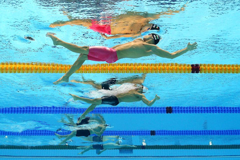 LONDON, ENGLAND - AUGUST 01: (From top) Gabor Balog of Hungary and Aschwin Wildeboer Faber of Spain compete in heat 2 the Men's 200m Backstroke on Day 5 of the London 2012 Olympic Games at the Aquatics Centre on August 1, 2012 in London, England. (Photo by Al Bello/Getty Images)
