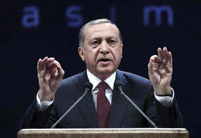 FILE - In this Nov. 22, 2016, file photo, Turkey's President addresses police officers in Ankara, Turkey. A state of emergency is still in force in Turkey following the July 15 coup attempt and the resulting government crackdown on alleged coup sympathizers has landed thousands in jail and forced tens of thousands of people from their jobs. In a two-month period, Turkish President Recep Tayyip Erdogan's government detained more than 100 journalists and closed down at least 100 news outlets, a report by the Committee to Protect Journalists, said on Tuesday, Dec. 12. (Murat Cetinmuhurdar, Presidential Press Service, Pool photo via AP)