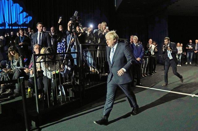 Prime Minister Boris Johnson arrives to deliver his keynote speech at the Conservative Party conference in Manchester (Jacob King/PA)