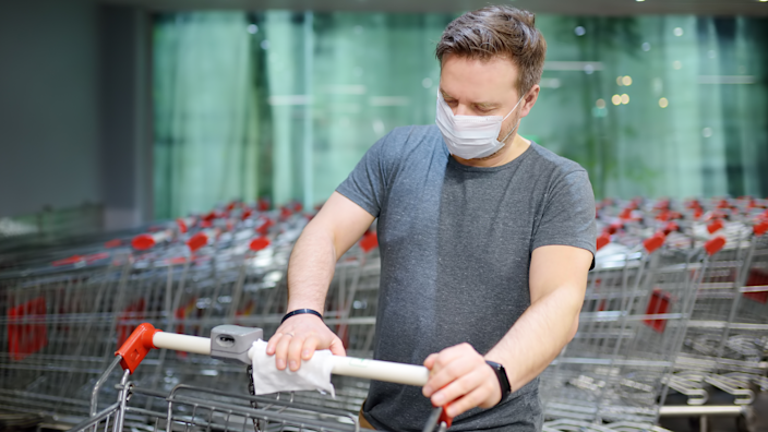 Use wipes to clean off basket handles or carts before you shop.