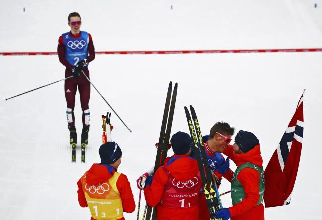 Cross-Country Skiing - Pyeongchang 2018 Winter Olympics - Men's 4x10 km Relay - Alpensia Cross-Country Skiing Centre - Pyeongchang, South Korea - February 18, 2018 - Denis Spitsov, Olympic athlete from Russia, looks on as Norway's Didirk Toenseth, Johnsrud Martin Sundby, Simen Hegstad Kreuger of Norway and Johannes Hoesflot Klaebo celebrate. REUTERS/Carlos Barria