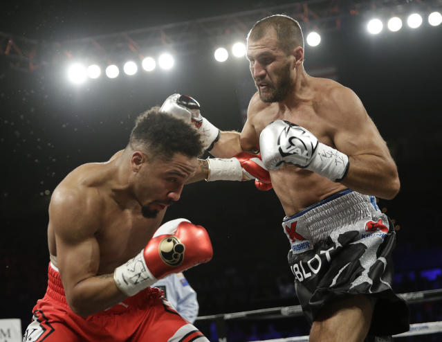 Sergey Kovalev, right, trades punches with Andre Ward during their June rematch. (AP)