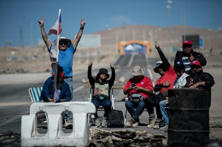 Miners of the Escondida copper mine, on strike, blocking a road outside of Escondida, some 145 km northeast of  Antofagasta, Chile, on March 8, 2017