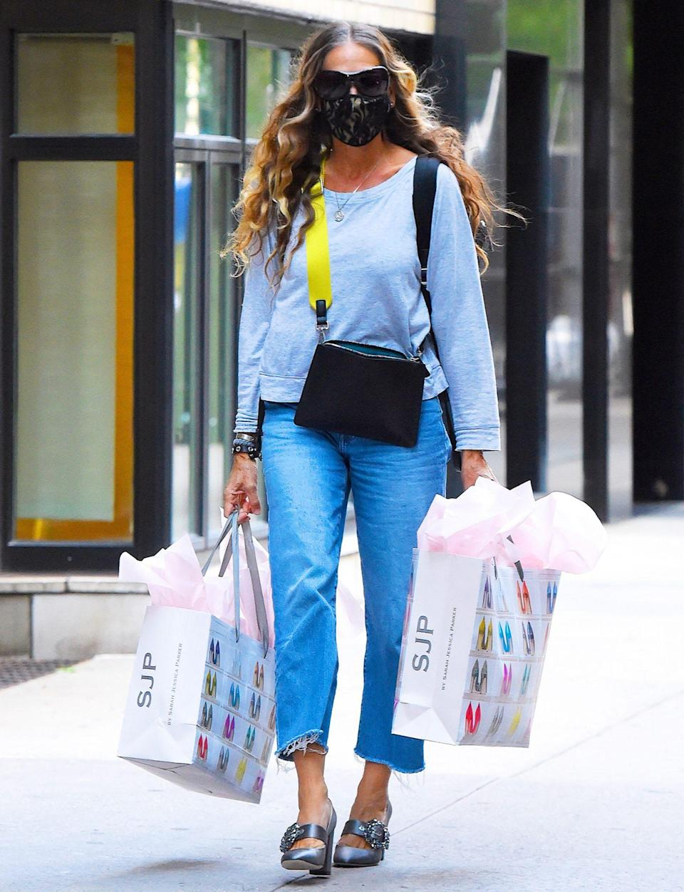 <p>Sarah Jessica Parker is spotted with bags full of her eponymous SJP merchandise on Wednesday in N.Y.C.</p>
