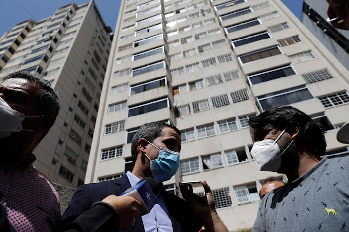 Opposition leader Juan Guaido speaks to the press at his residential building in Caracas, Venezuela, Monday, July 12, 2021. Guaido said security forces threatened his driver when he and his driver arrived home Monday. (AP)