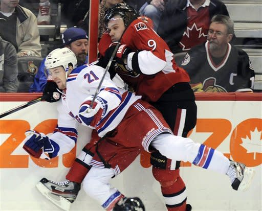 Ottawa Senators' Milan Michalek, right, is hit into the boards by New York Rangers' Derek Stepan during the first period of Game 4 of a first-round NHL hockey Stanley Cup playoff series against the Ottawa Senators in Ottawa, Ontario, Wednesday, April 18, 2012. (AP Photo/The Canadian Press, Sean Kilpatrick)