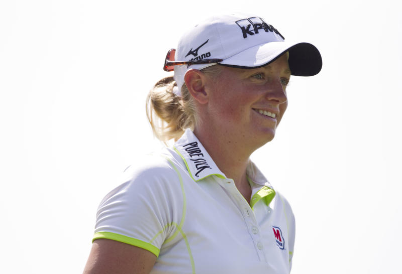 Stacy Lewis watches her shot off the 18th tee during the second round of the LPGA NW Arkansas Championship golf tournament on Saturday, June 22, 2013, in Rogers, Ark. (AP Photo/Beth Hall)