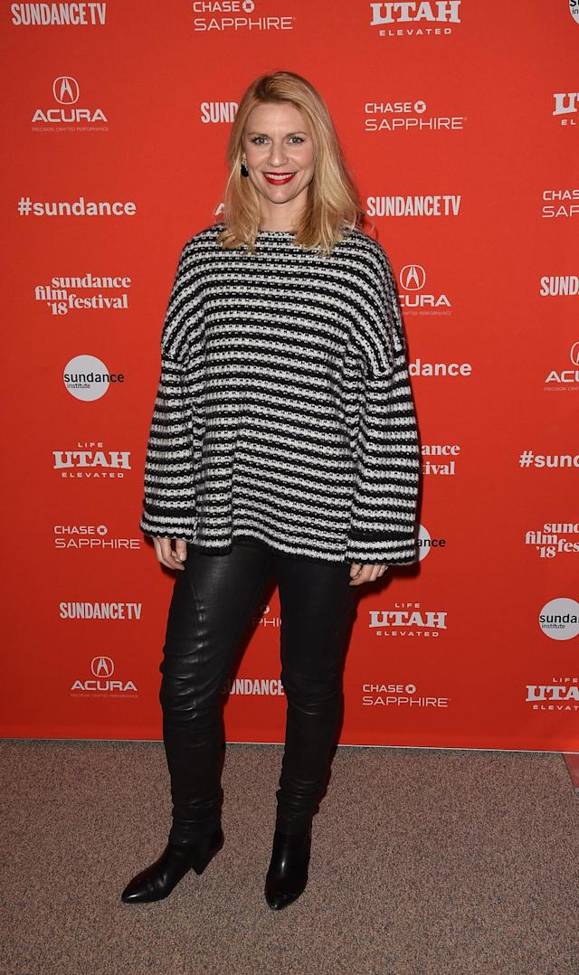 <p>Danes looks comfy and casual in a black-and-white striped sweater, leather pants, and black Chelsea boots in Park City, Utah. (Photo: Getty Images) </p>