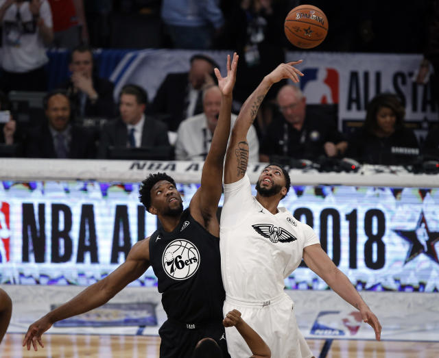 Team Stephen's center Joel Embiid, left, of the Philadelphia 76ers leaps for the tip off won by Team LeBron's forward Anthony Davis of the New Orleans Pelicans during the first half of the NBA All-Star basketball game on Sunday. (AP)