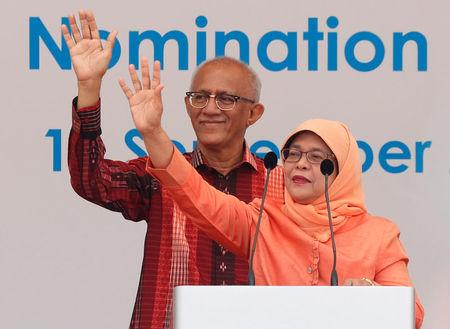 Singapore's President-elect Halimah Yacob and her husband Mohammed Abdullah Alhabshee address supporters before leaving the nomination centre in Singapore September 13, 2017. REUTERS/Edgar Su