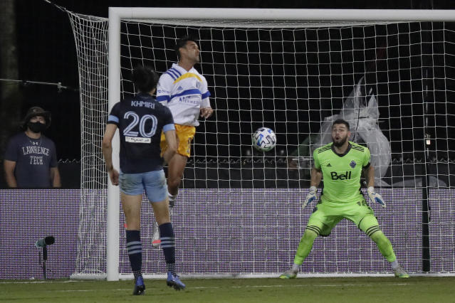 Vancouver Whitecaps goalkeeper Maxime Crepeau, right, reacts as San Jose Earthquakes forward Chris Wondolowski, second from left, heads the ball for a goal as Jasser Khmiri (20) defends during the second half of an MLS soccer match Wednesday, July 15, 2020, in Kissimmee, Fla. (AP Photo/John Raoux)