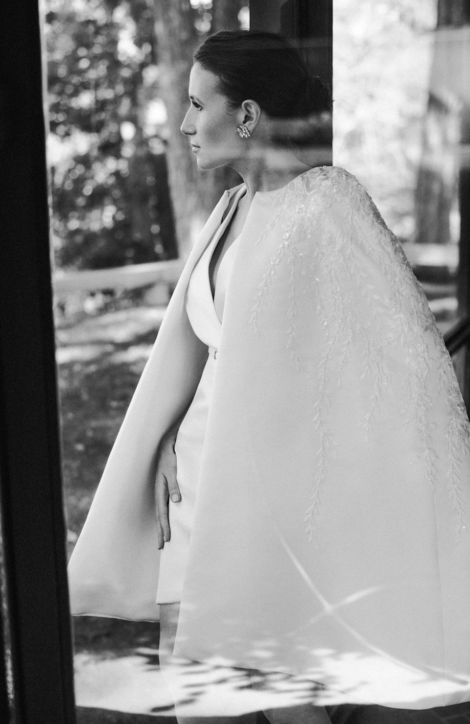 The signing of the Ketubah was an important moment for us, and I wanted to wear something understated and classic. The cape is embellished with floral embroidery, crystals, and pearls.