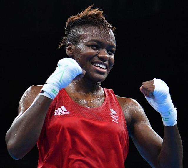 Great Britain's Nicola Adams (red) is one of several high-profile female amateur boxers to have turned professional in recent times (AFP Photo/Yuri CORTEZ)