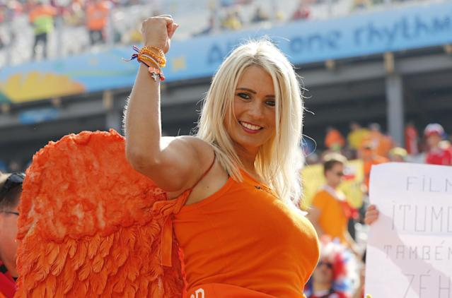 A Dutch supporter smiles prior to the group B World Cup soccer match between the Netherlands and Chile at the Itaquerao Stadium in Sao Paulo, Brazil, Monday, June 23, 2014. (AP Photo/Frank Augstein)