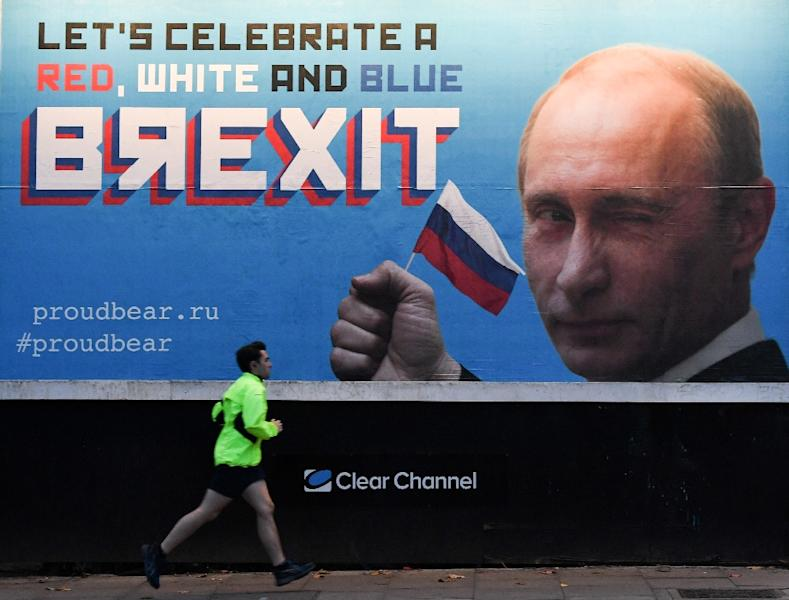 """A Brexit-themed billboard depicting Russian President Vladimir Putin reads """"Lets celebrate a red, white and blue Brexit"""" (AFP Photo/Daniel SORABJI)"""