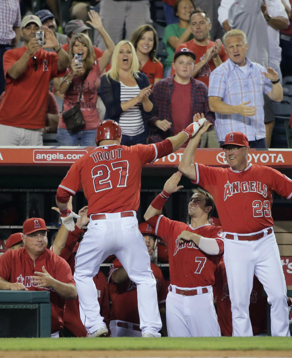 Los Angeles Angels' Mike Trout is congratulated after his home run during the eighth inning of a baseball game against the Boston Red Sox on Saturday, Aug. 9, 2014, in Anaheim, Calif. (AP Photo/Jae C. Hong)