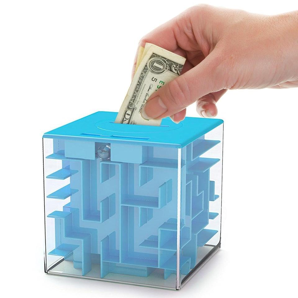 """<p>Make them work for their gift with this <a href=""""https://www.popsugar.com/buy/AGreatLife-Money-Maze-Puzzle-Box-328450?p_name=%20AGreatLife%20Money%20Maze%20Puzzle%20Box&retailer=amazon.com&pid=328450&price=13&evar1=moms%3Aus&evar9=32519221&evar98=https%3A%2F%2Fwww.popsugar.com%2Ffamily%2Fphoto-gallery%2F32519221%2Fimage%2F44850304%2FAGreatLife-Money-Maze-Puzzle-Box&list1=gifts%2Choliday%2Cgift%20guide%2Cgifts%20for%20kids%2Ckid%20shopping%2Ctweens%20and%20teens%2Cgifts%20for%20teens&prop13=api&pdata=1"""" class=""""link rapid-noclick-resp"""" rel=""""nofollow noopener"""" target=""""_blank"""" data-ylk=""""slk:AGreatLife Money Maze Puzzle Box""""> AGreatLife Money Maze Puzzle Box </a> ($13). Simply place money inside the brain teaser, and they have to solve the mystery.</p>"""