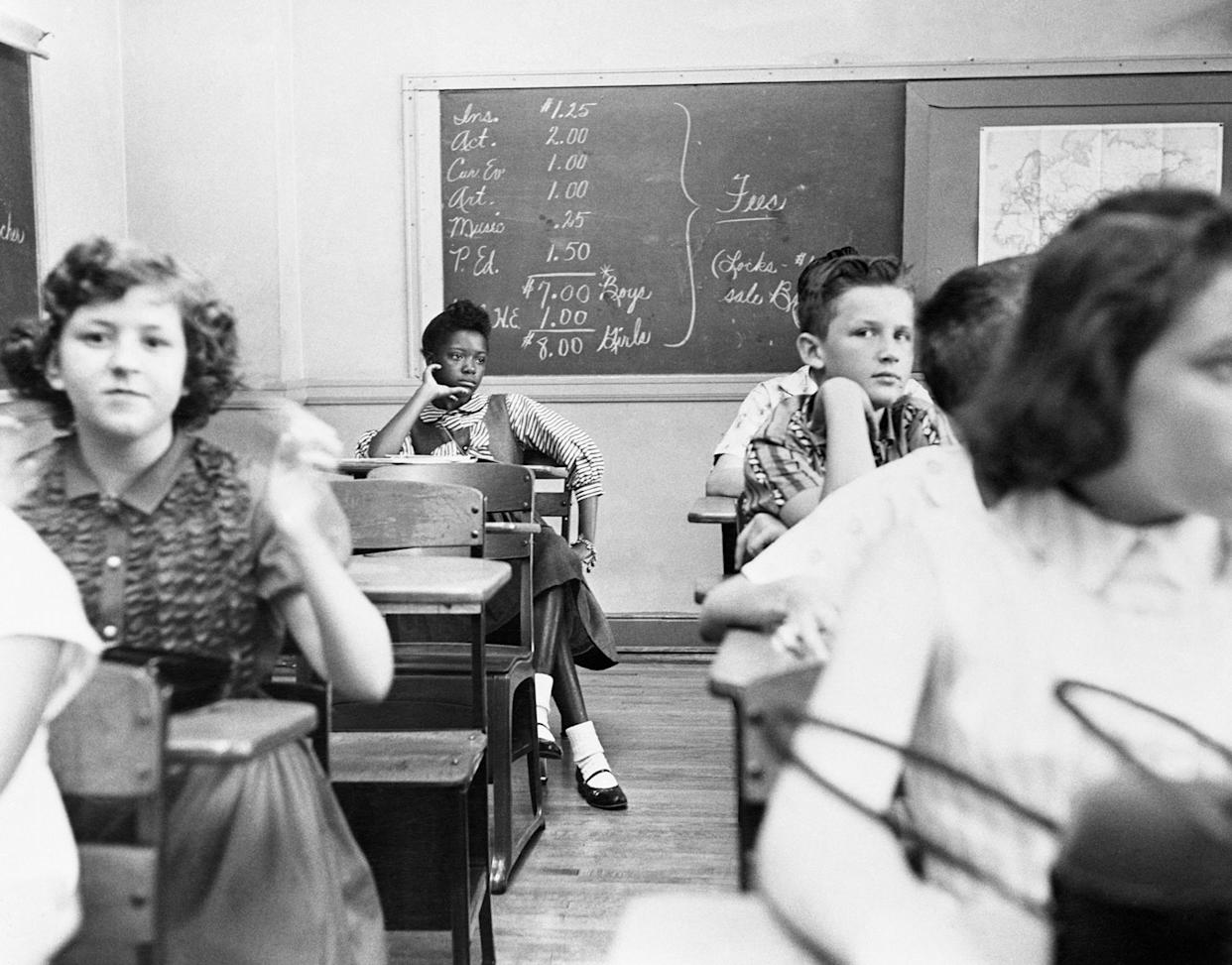 An African-American girl sits in the back row of a classroom in a Charlotte, N.C., school as integration got underway on Sept. 7, 1957. Three local schools were integrated in the city with only one minor disturbance. (Photo: Bettmann/Getty Images)