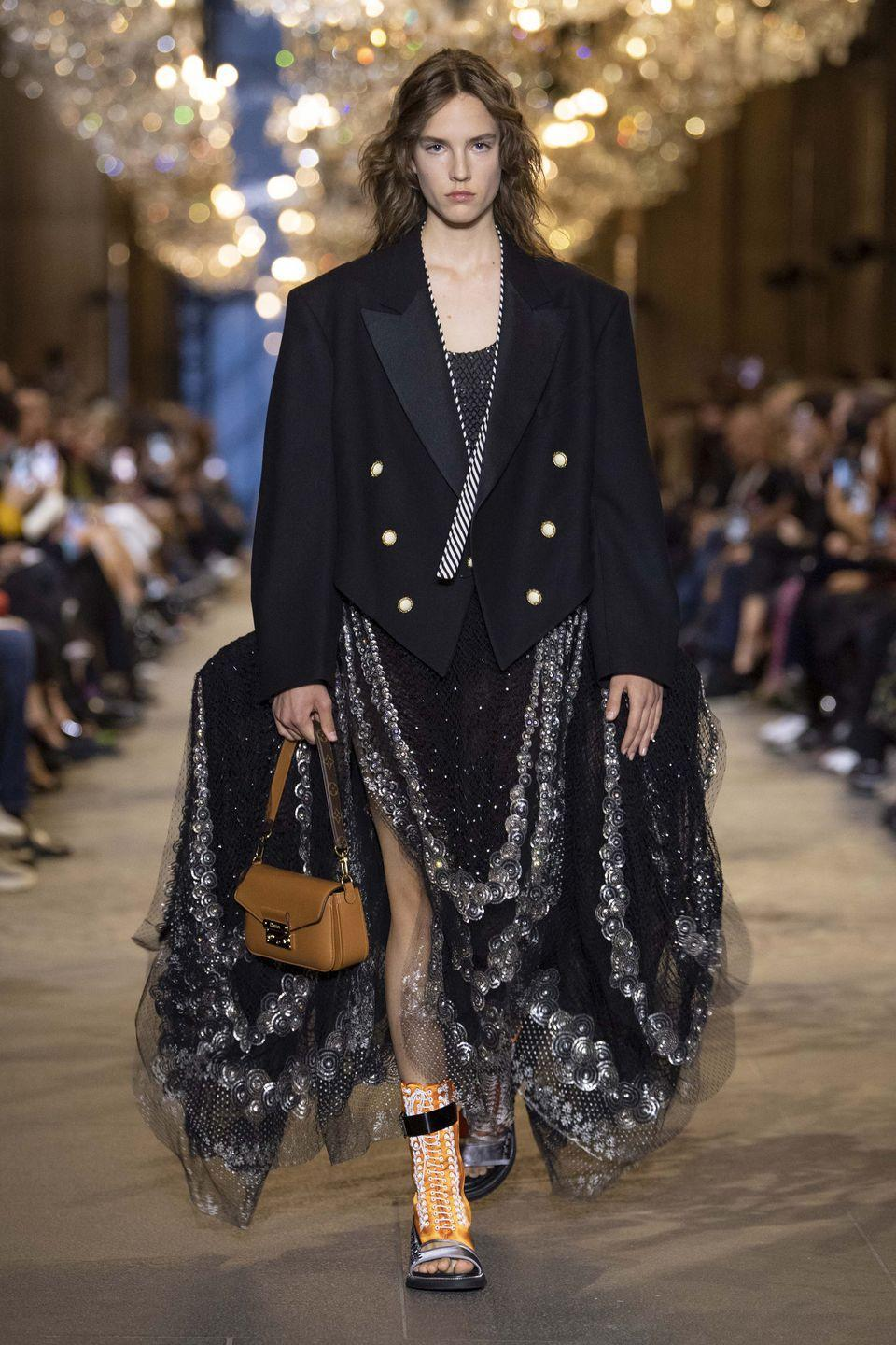 """<p>Nicolas Ghesquière described the spring/summer 2022 collection as """"le grand bal of Time"""", celebrating opulence with a fairytale collection which nodded to the house's history but with the relaxed touches that the creative director has become known for. Louis Vuitton is currently celebrating what would have been its founder's 200th birthday, so it was certainly a fitting mood – and a beautiful end to the first real-life Paris Fashion Week we've been treated to in a few years.</p>"""